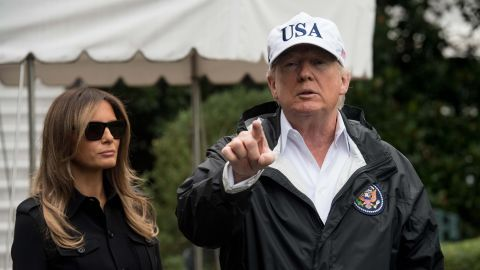 US President Donald Trump speaks to the press with First Lady Melania Trump before they depart the White House in Washington, DC, on September 14, 2017 for Florida.The Trumps will visit areas affected by Hurricane Irma. / AFP PHOTO / NICHOLAS KAMMNICHOLAS KAMM/AFP/Getty Images