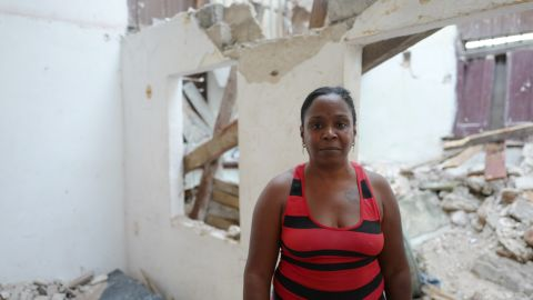 Litza Peñalver Sierra stands on Wednesday, September 13,  in the rubble strewn apartment where two brothers died after Hurricane Irma caused their ceiling to cave in on them. Penñalver's family lives in the same building and she is afraid they also could die there if the rest of the building collapses.