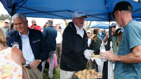 On September 14, President Donald Trump, Vice President Mike Pence and first lady Melania Trump hand out food to people impacted by Hurricane Irma in Naples, Florida.
