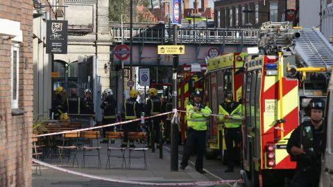 Members of the emergency services work near Parsons Green underground tube station in west London on Friday, following an incident on an underground tube carriage at the station.