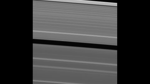 """Two days before its death plunge into Saturn, Cassini took this image of Saturn's A ring. The ring features what scientists call a lone """"propeller"""" -- a feature created by small moonlets in the rings."""