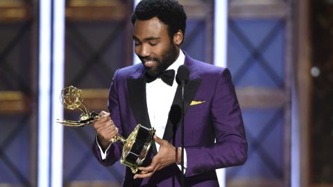 """Donald Glover accepts the award for outstanding directing for a comedy series for the """"Atlanta"""" episode """"B.A.N."""" at the 69th Primetime Emmy Awards."""
