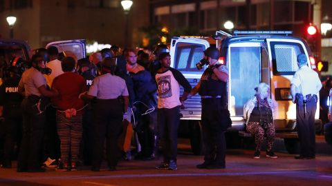 Police make multiple arrests after a peaceful protest turned violent response to a not guilty verdict in the trial of former St. Louis police officer Jason Stockley Sunday, Sept. 17, 2017, in St. Louis. Stockley was acquitted on Friday in the 2011 killing of a black man following a high-speed chase. (AP Photo/Jeff Roberson)