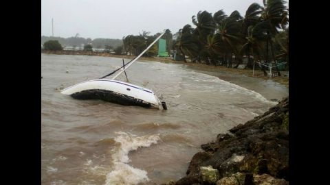A boat is overturned off the shore of Sainte-Anne, Guadeloupe, on September 19.