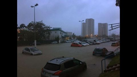 Floodwaters surround cars in Pointe-a-Pitre on September 19.