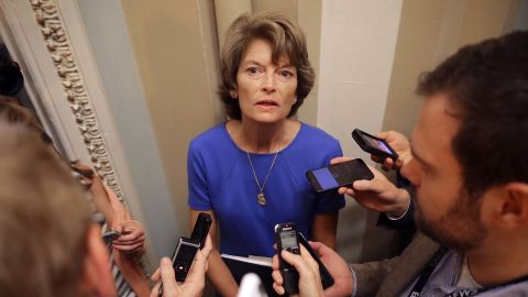 Sen. Lisa Murkowski (R-AK) talks with reporters before attending the weekly Senate Republican policy luncheon at the Capitol July 18.