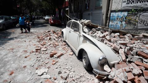 A car is crushed by debris in Mexico City on September 19.