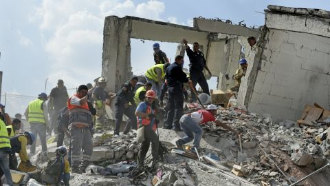 Rescuers work survivors amid the rubble of a collapsed building after a powerful quake in Mexico City on September 19, 2017. A powerful earthquake shook Mexico City on Tuesday, causing panic among the megalopolis' 20 million inhabitants on the 32nd anniversary of a devastating 1985 quake. The US Geological Survey put the quake's magnitude at 7.1 while Mexico's Seismological Institute said it measured 6.8 on its scale. The institute said the quake's epicenter was seven kilometers west of Chiautla de Tapia, in the neighboring state of Puebla.  / AFP PHOTO / Alfredo ESTRELLA        (Photo credit should read ALFREDO ESTRELLA/AFP/Getty Images)