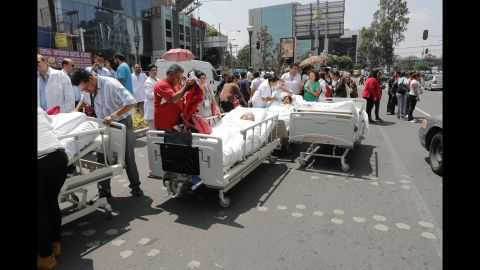 Patients from a Mexico City hospital receive treatment outside after the hospital was evacuated on September 19.