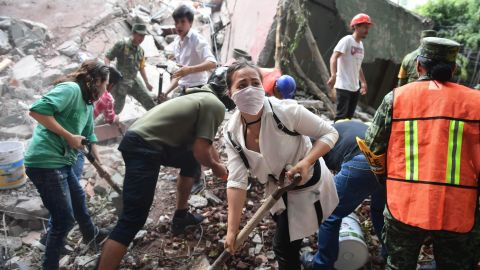 Emergency workers remove debris as they search for survivors in Mexico City on September 19.