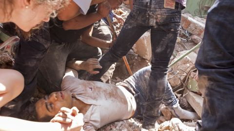 A man is rescued under rubble in Mexico City's Condesa area on September 19.