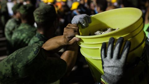 Soldiers remove debris from a collapsed building in Mexico City on September 20.