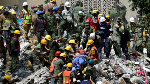 A survivor is pulled out of rubble in Mexico City on September 20.