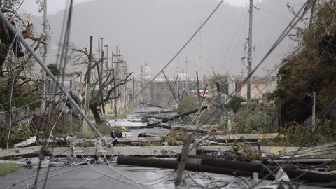 Power lines are scattered across a road in Humacao, Puerto Rico, on September 20.