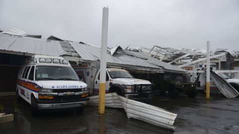 Rescue vehicles are trapped under an awning in Humacao on September 20.