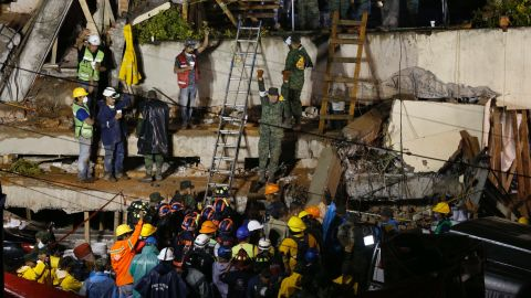 """Rescuers in Mexico City work to save a child <a href=""""http://www.cnn.com/2017/09/20/americas/mexico-city-girl-trapped-school/index.html"""" target=""""_blank"""">trapped inside the Enrique Rebsamen elementary school </a>on September 20. Rescue workers said they believed they'd made contact with a girl trapped in the rubble at the school. But by the next afternoon, navy official Angel Enrique Sarmiento said all the school's children had been accounted for and there was no student in the rubble. <a href=""""http://www.cnn.com/2017/09/21/americas/mexico-earthquake/index.html"""" target=""""_blank"""">He apologized</a> for the confusion."""