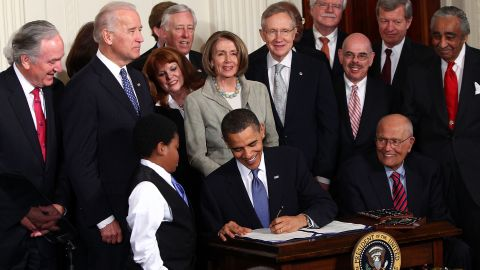 WASHINGTON - MARCH 23:  U.S. President Barack Obama (C) signs the Affordable Health Care for America Act during a ceremony with fellow Democrats in the East Room of the White House March 23, 2010 in Washington, DC. The historic bill was passed by the House of Representatives Sunday after a 14-month-long political battle that left the legislation without a single Republican vote.  (Photo by Win McNamee/Getty Images)