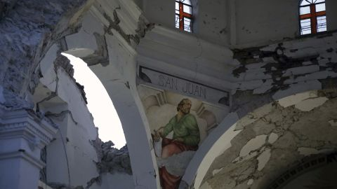The quake left gaping holes in what's left of the church.