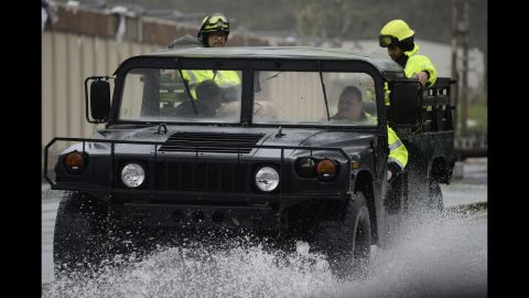 Rescue workers drive through a flooded road in Humacao, Puerto Rico, on Wednesday, September 20.