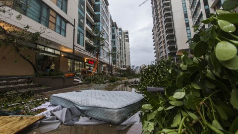 A mattress that fell from the third floor is surrounded by debris outside a San Juan apartment complex on September 20.