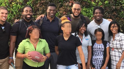 NFL players and women of Lily House, a rehabilitation facility for victims of sex trafficking. CNN has blurred some of the faces in this photo in order to respect their privacy.