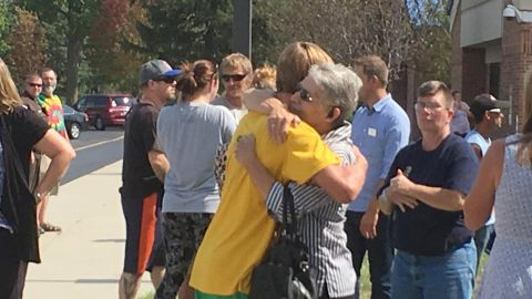People embrace outside Mattoon High School after the shooting on Sept. 20, 2017.
