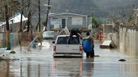 Residents evacuate after the passing of Hurricane Maria in Puerto Rico.