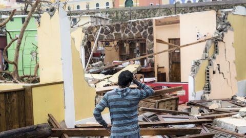 A resident of the La Perla neighborhood in San Juan, Puerto Rico, surveys the damage.