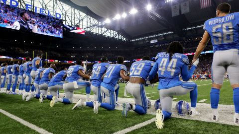 Members of the Detroit Lions take a knee during the National Anthem before their game against the Atlanta Falcons at Ford Field in Detroit.