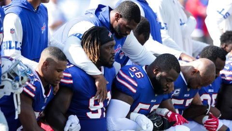 Buffalo Bills players kneel during the National Anthem before their game against the Denver Broncos at New Era Field in Orchard Park, New York.