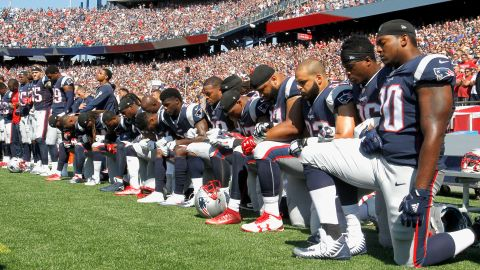 Following President Donald Trump's comments at an Alabama rally on September 22, 2017, an unprecedented number of players took a knee and locked arms on the field in a dramatic show of defiance. Here, members of the New England Patriots -- Trump's all-time favorite team -- kneel during the National Anthem before a game against the Houston Texans at Gillette Stadium on September 24 in Foxboro, Massachusetts.