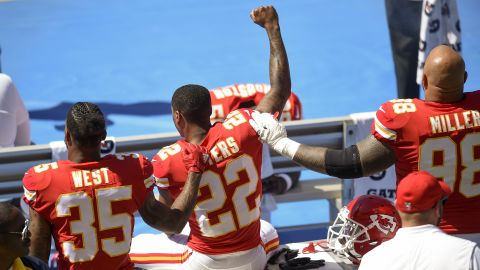 Sep 24, 2017; Carson, CA, USA; Kansas City Chiefs defensive back Marcus Peters (22) protests next to running back Charcandrick West (35) and defensive tackle Roy Miller (98) during the National Anthem prior to the game against the Los Angeles Chargers at StubHub Center. Mandatory Credit: Kelvin Kuo-USA TODAY Sports
