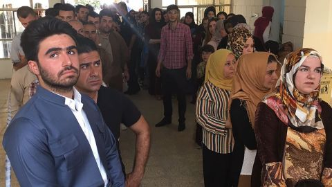 Kurds stand in line to vote at the Azadi neighborhood polling station in Irbil on Monday.