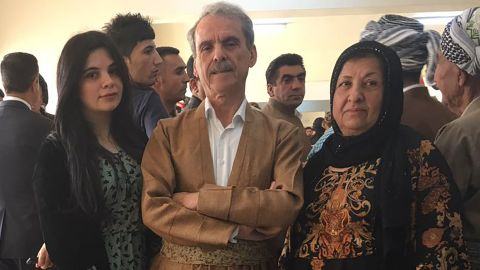 Aso Karim Mohamad, a former MP and ex-Peshmerga fighter, with his wife and daughter at a polling station in Irbil.
