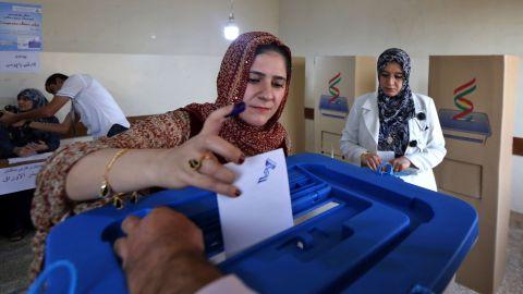 An Iraqi Kurdish woman casts her vote in Irbil on Monday.