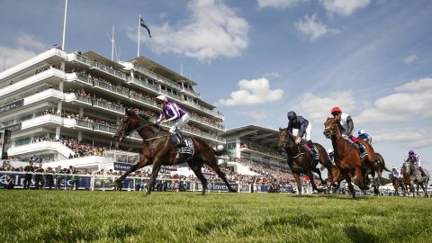 Irish jockey Padraig Beggy rode trainer Aidan O'Brien's huge outsider Wings Of Eagles (left) to victory in the Derby, finishing ahead of Cliffs Of Moher (center).