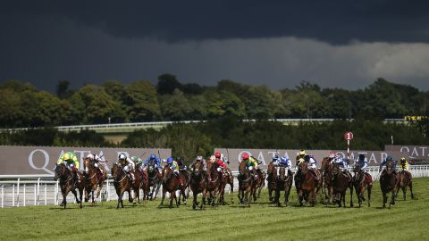 Frankie Dettori rode Lancelot Du Lac (left) to victory in the esteemed Stewards Cup on a stormy day five of the Qatar Goodwood Festival.