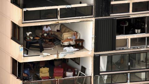 An apartment building is missing a wall in San Juan, Puerto Rico, on Monday, September 25, nearly a week after Hurricane Maria devastated the US commonwealth. Power is still out in most places, and communications remain almost nonexistent on the island of 3.4 million people.
