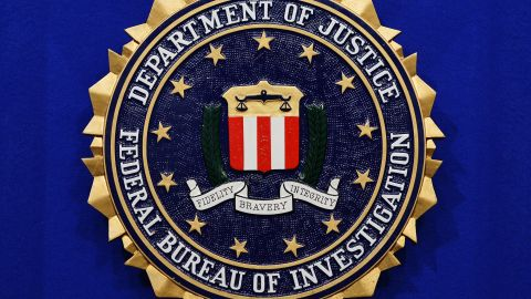 """The Federal Bureau of Investigation (FBI) seal is seen on the lectern following a press conference announcing the FBI's 499th and 500th additions to the """"Ten Most Wanted Fugitives"""" list on June 17, 2013 at the Newseum in Washington, DC. (MANDEL NGAN/AFP/Getty Images)"""