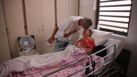 SAN JUAN, PUERTO RICO - SEPTEMBER 26: Rafael Robles-Ortiz kisses his mother Josefina Ortiz who is staying at the Hermanitas de los Ancianos Desamparados facility which cares for the elderly as they deal with the aftermath of Hurricane Maria on September 26, 2017 in San Juan, Puerto Rico. Mr. Robles-Ortiz is concerned for his mother and hopes aid -- including fuel for the facilities generators, as well as food and medicine for his mother -- gets through after Hurricane Maria, a category 4 hurricane, devastated the island.  (Photo by Joe Raedle/Getty Images)