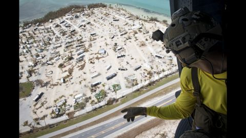 A pararescueman from the 48th Rescue Squadron scans the ground from an HH-60G Pave Hawk, Sept. 12, 2017, in the skies over South Florida. The 563d Rescue Group prepositioned aircraft and personnel in support of FEMA and U.S. Northern Command for rescue operations after Hurricane Irma made landfall in Florida. (U.S. Air Force photo by Staff Sgt. Ryan Callaghan)
