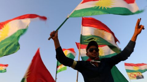 """Syrian Kurds wave the Kurdish flag, in the northeastern Syrian city of Qamishli on September 27, 2017, during a gathering in support of the independence referendum in Iraq's autonomous northern Kurdish region. Iraq's Kurds announced a massive """"yes"""" vote for independence following a referendum that has incensed Baghdad and sparked international concern. / AFP PHOTO / DELIL SOULEIMAN        (Photo credit should read DELIL SOULEIMAN/AFP/Getty Images)"""