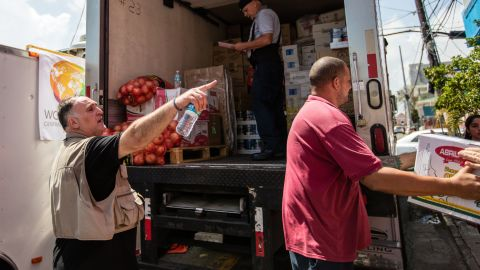 Chef Jose Andres, left, directs volunteers after a delivery of food.