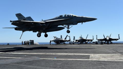 """An F/A-18F Super Hornet lands on the US navy's super carrier USS Dwight D. Eisenhower (CVN-69) (""""Ike"""") in the Mediterranean Sea on July 6, 2016.The US aircraft carrier is deployed in support of Operation Inherent Resolve, maritime security operations and theater security cooperation efforts in the US 6th Fleet area of operations. Air Wings embarked aboard conducted strikes against the Islamic State group in Libya , Iraq and Syria.   / AFP / ALBERTO PIZZOLI        (Photo credit should read ALBERTO PIZZOLI/AFP/Getty Images)"""