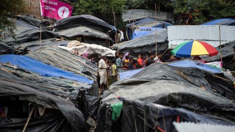 Rohingya Muslim refugees line up in Kutupalong refugee camp in the Bangladeshi district of Ukhia on September 28.