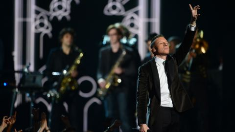 """Macklemore performs the song """"Same Love"""" at the 56th Grammy Awards at the Staples Center in Los Angeles, California, January 26, 2014."""