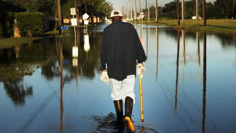 ORANGE, TX - SEPTEMBER 07: Paul Morris checks on neighbors homes in a flooded district of Orange as Texas slowly moves toward recovery from the devastation of Hurricane Harvey on September 7, 2017 in Orange, Texas. Almost a week after Hurricane Harvey ravaged parts of the state, some neighborhoods still remained flooded and without electricity. While downtown Houston is returning to business, thousands continue to live in shelters, hotels and other accommodations as they contemplate their future.  (Photo by Spencer Platt/Getty Images)