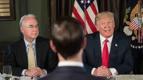 US President Donald Trump speaks at a meeting with administration officials, including Health and Human Services Secretary Tom Price (L), on the opioid addiction crisis at the Trump National Golf Club in Bedminster, New Jersey, on August 8.