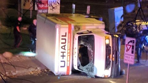 A rental truck lies on its side in Edmonton, Alberta, after a high-speed chase early Sunday.