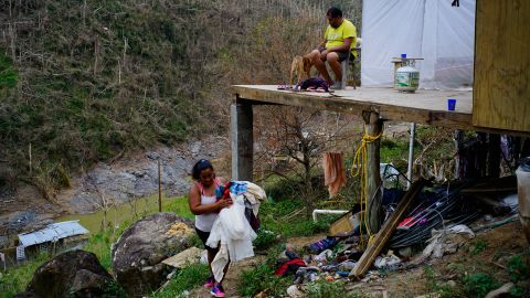 """Yadira Sortre and William Fontan Quintero clean their house, destroyed by Hurricane Maria in in Moravis, Puerto Rico, Sunday, Oct. 1, 2017. """"We lost everything."""" Fontan said. They have three children, one lives in Chicago and two live with them in Puerto Rico."""